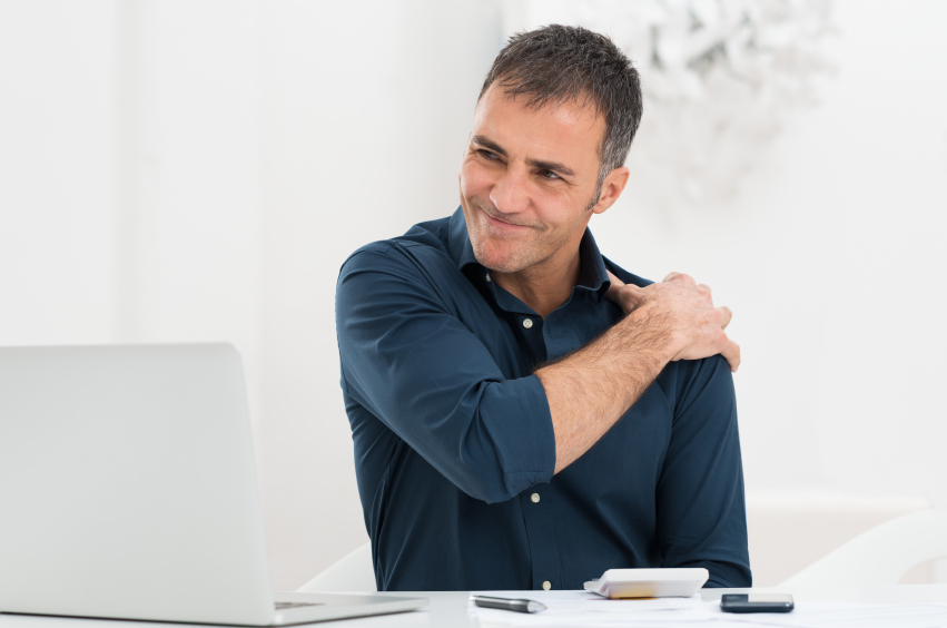 Businessman Suffering From Shoulder Pain