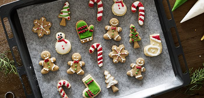 Sugar cookies on tray, decorated with icing.