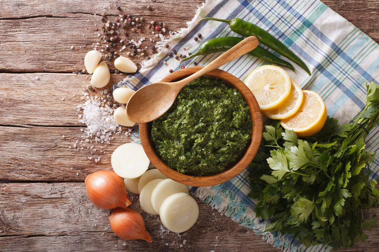 Green spicy sauce, chimichurri, and ingredients.