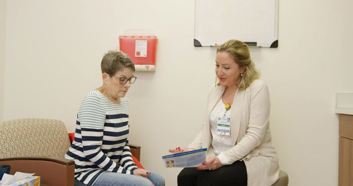 Dr. Oakley consults with female patient about pelvic floor disorders