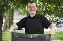 Robert Gross holding us jeans he wore when he was 400 pounds