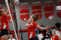 Volleyball player spiking the ball