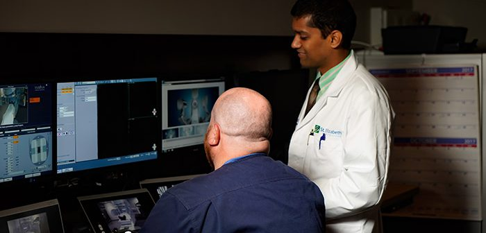 Dr. Shah reviews scans of prostate cancer with tech