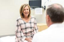 Breast cancer patient consulting with doctor about latest treatment options.