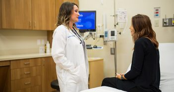 Certified nurse-midwife Allie Forbes discusses birth plan with patient.