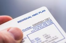 man holding HMO plan card