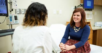 Dr. Lily Hahn talking with female patient about women's health.