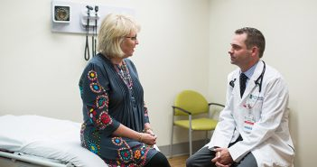 Dr. Dan Flora meets with female cancer patient.
