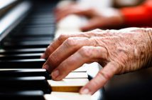 Arthritic hands playing piano.