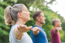 Men and women doing yoga and exercising to relieve upper joint pain.