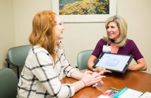 Genetic counselor discussing results with patient.