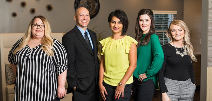 Five doctors who are part of the new St. Elizabeth Concierge Medicine team are standing in an office.