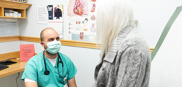 Dr. Schutzman talking with a woman patient.